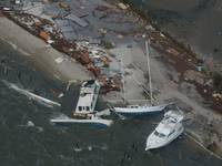 Boats are washed up on shore along the Florida coast during Hurricane Ivan in 2004. (U.S. Coast Guard photo by Stacey Pardini)