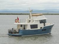 This stern-quarter view shows the very utilitarian covered after deck with room for crab traps and other cargo. Photo: Haig-Brown/Cummins