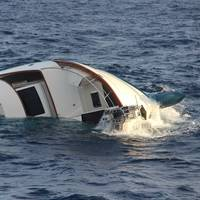 A US Coast Guard helicopter crew rescued four men from a life raft on December 15, 2019 after they were forced to abandon the 80-foot sinking yacht, Clam Chowder, approximately 25 nautical miles northwest of Aguadilla, Puerto Rico. (U.S. Coast Guard photo)