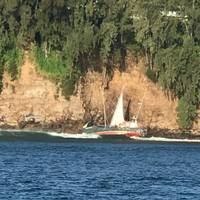 The Coast Guard responds to a 63-foot motor vessel, Midway Island, grounded off Ale Ale'a Point, Hilo, February 4, 2020. At 5:33 p.m. Monday, Sector Honolulu watchstanders received a report from Hilo Fire Department of the grounded vessel on the rocks with a mariner aboard. (Photo: U.S. Coast Guard)