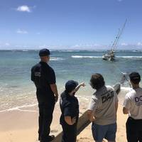 The Coast Guard, State of Hawaii, and salvors are working to remove the sailing vessel, Steady Beat, aground near Waikiki Reef Hotel, March 22, 2020. The owner's insurance company has hired a salvage team to remove the 35-foot, double masted vessel. (U.S. Coast Guard photo by Russ Strathern)