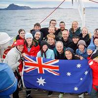 Commanding Officer of STS Young Endeavour, Lieutenant Commander Gavin Dawe OAM RAN (front, centre), and World Voyage Passage One Youth Crew celebrate rounding Cape Horn on Australia Day 2015.