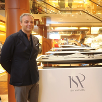 from the left, Giuseppe Palumbo, CEO of Palumbo Superyachts and Francesco Carbone, General Manager of Palumbo Superyachts by side ISA Classic 65 mockup at Louis Vuitton boutique (Photo: ISA Yachts)