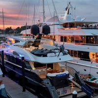 The 123' motor yacht Temptation and the 198' motor yacht Blue Moon represented some of the diverse chartering options in New England at the 2018 Newport Charter Yacht Show presented by Helly Hansen Newport. (photo credit: Billy Black)