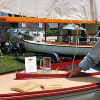 "Richard Honan of Winthrop, MA, with his boat Proud Mary II, the 2014 winner of the ""I Built it Myself"" Award sponsored by Interlux® at the WoodenBoat Show."