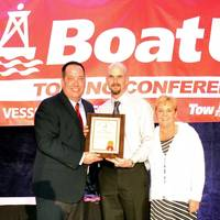 (left to right) BoatUS V.P. and Director of Towing Services Adam Wheeler, TowBoatUS Chickamauga Captain Shane O'Neil and Stacey O'Neil