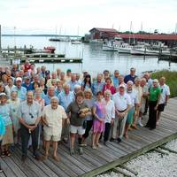 Several volunteers of the Chesapeake Bay Maritime Museum gathered at a reception honoring their service and dedication. Last year, more than 275 volunteers collectively contributed 28,235 hours of service to the nonprofit, helping with all aspects of CBMM's operations. (Photo: CBMM)