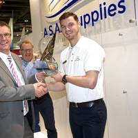 Shaun Wigley - Managing Director accepting the 'Sales growth achievement award 2014' on behalf of the team at A.S.A.P. Supplies by Adrian Foster - UK Marketing Manager at Parker Racor. Peter Edwards with his award in the background (Photo: A.S.A.P Supplies)