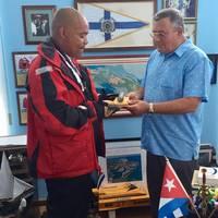Victor Mooney with Comodoro, Jose Escrich at Club Nautico International Hemingway de Cuba in Havana.