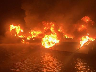 A 36-foot fishing vessel ablaze near Dauphin Island, Ala. (U.S. Coast Guard photo)