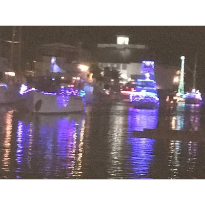 Boats line up for West End Boat Parade with Southern Yacht Club, background. New Orleans. Photo by Lisa Overing