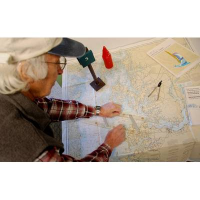 Captain Jerry Friedman, a USCG-licensed Master—shown here using parallel rulers to chart a course—will teach a chart navigation course at the Chesapeake Bay Maritime Museum to help boaters better understand how to plan for a cruise using navigation charts, course plotting, and navigational aids when electronics are not available.