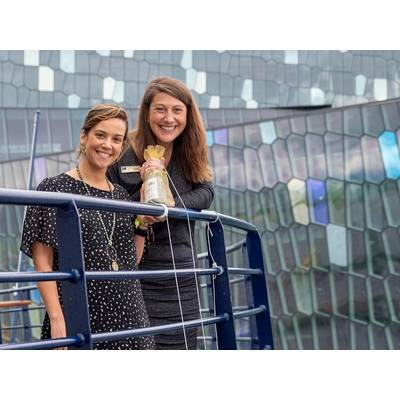 Jen Martin, Director of Field Staff & Expedition Development, and Ana Esteves, Director, Hotel Operations, toss the champagne bottle at the christening of National Geographic Endurance in Reykjavik, Iceland.  Photo credit: Michael S. Nolan