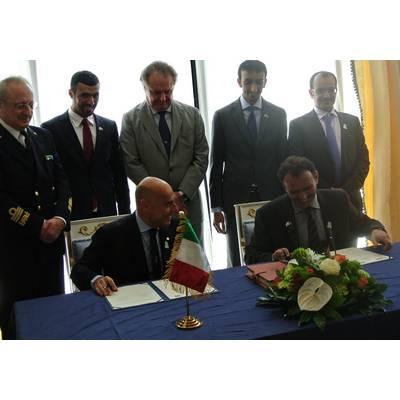 Ugo Salerno (seated, left) signing the agreement with Drydocks World