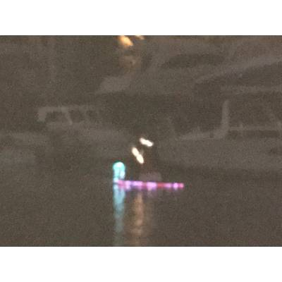 Santa on a paddle board. West End Boat Parade, New Basin Canal. New Orleans. Photo by Lisa Overing