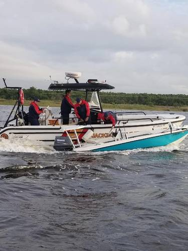 A Coast Guard Station Mayport boatcrew and good Samaritans rescue three people from the water April 23, 2018, after their vessel capsized near Blount Island in Jacksonville, Florida.(U.S. Coast Guard photo courtesy of Coast Guard Station Mayport)